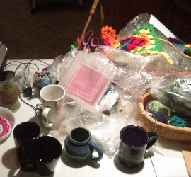 A table full of mugs and stuff.